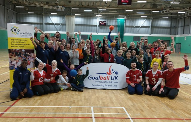 Goalball participants cheering by Goallball UK and BucksVision banners