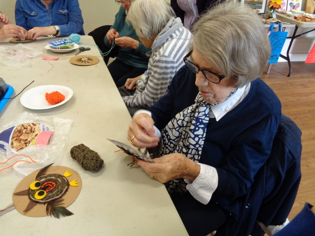 Lady concentrating on craft